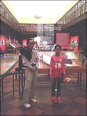 Vo Tan Phong - Grandpa and Granddaughter in front of Gutenberg Bible