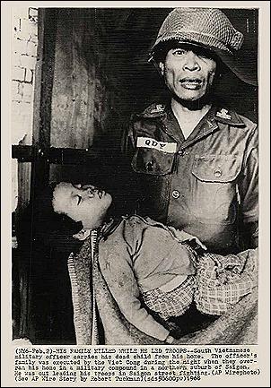 soldier holding dead family member